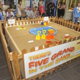 5 Grand in the Sand -